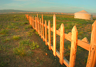 The Only fence in Mongolia  by Ron Gluckman