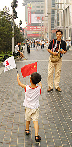 Beijing Olympics celebrations on Wangfujing in China's capital by Ron Gluckman