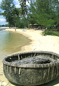 Coracle, woven basket boat, on beach of Phu Quoc Island, Vietnam, by Ron Gluckman